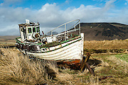 Dyrholaey fishing machinery and boat at sunset. Southern Iceland