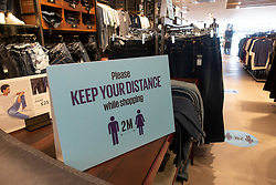 Edinburgh, Scotland, UK. 19 June, 2020. Several shops at Straiton Retail Park outside Edinburgh have opened. Signage warning customers to maintain 2m social distancing is positioned outside and inside shops.Pictured; Next has opened its store at Straiton and has comprehensive signage inside and outside. Screens are located at tills. Iain Masterton/Alamy Live News