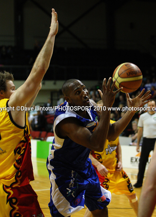 Saints import Erron Maxey juggles the ball under pressure from Mike Homik.<br /> NBL - Wellington Saints v Waikato Pistons at TSB Bank Arena, Wellington. Saturday, 29 May 2010. Photo: Dave Lintott/PHOTOSPORT