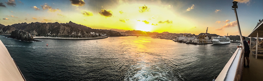 An iPhone6 panoramic image of the ship leaving the port of Muscat. Images from the MSC Musica cruise to the Persian Gulf, visiting Abu Dhabi, Khor al Fakkan, Khasab, Muscat, and Dubai, traveling from 13/12/2015 to 20/12/2015.