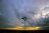 Windmill and clouds on the great plains. Near Malta, Montana
