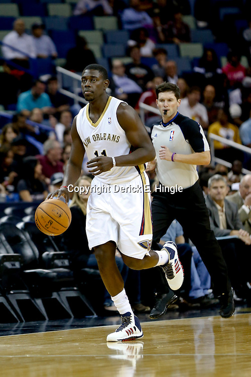 Oct 23, 2013; New Orleans, LA, USA; New Orleans Pelicans point guard Jrue Holiday (11) against the Miami Heat during the first half of a preseason game at New Orleans Arena. Mandatory Credit: Derick E. Hingle-USA TODAY Sports