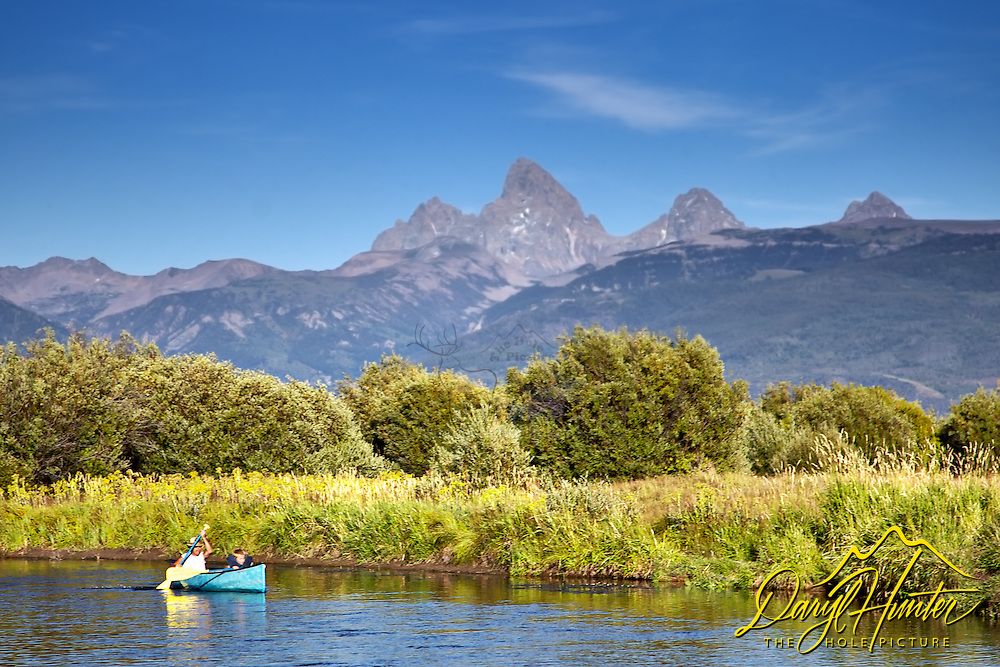 Canoeing on the Teton River under the Grand Tetons in Teton Valley Idaho