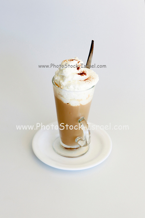 Cappuccino topped with whipped cream on white background