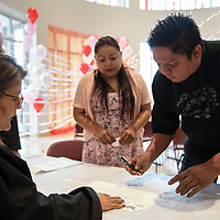Christopher John and Melvina Yazzie sign their marriage certificate after marrying in the McKinley County Courthouse on Valentines Day, Thursday, Feb. 14.