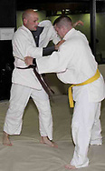 Dan Weaver, from Troy (left) trains with Chad Davidson, from Vandalia during a judo class in the Miami County YMCA, Thursday, May 31st.  Weaver will be competing in the Ohio Police and Fire Games June 9-15.