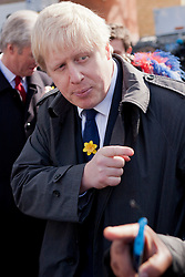 © Licensed to London News Pictures. 08/03/2012. London, UK. Mayor of London Boris Johnson pictured in the Roman Road Market today (08/03) to publicise the eastern extension of the Barclays Bike cycle hire scheme which launches today. Photo credit : James Gourley/LNP