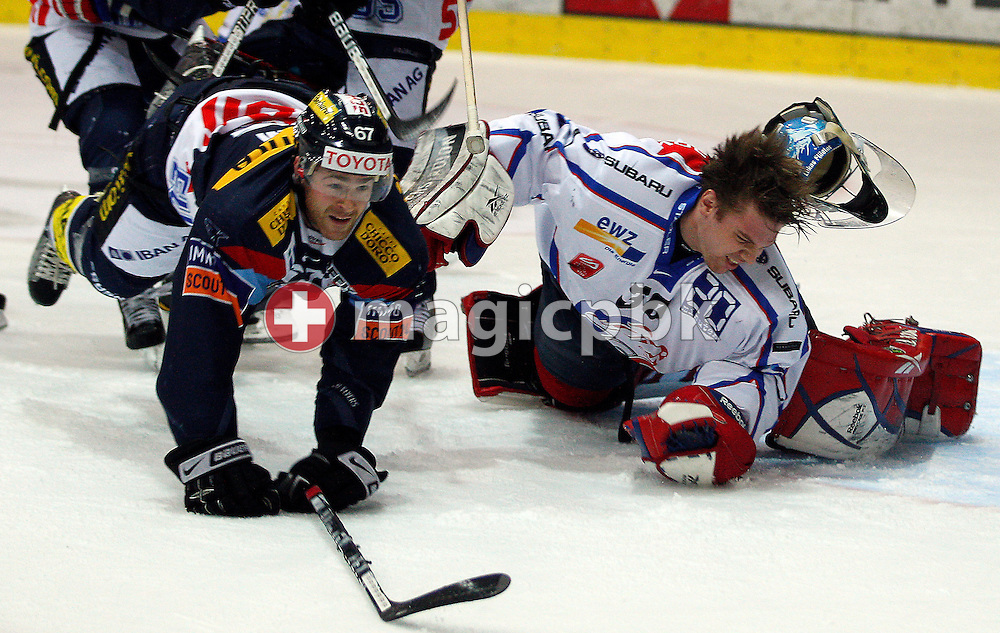 Kloten Flyers forward Romano Lemm (L) commits a foul against ZSC Lions goaltender Lukas Flueeler (R) during ice hockey game three of the Swiss National League A Playoff Quarterfinal between Kloten Flyers and ZSC Lions held at the Kolping Arena in Kloten, Switzerland, Thursday, March 3, 2011. (Photo by Patrick B. Kraemer / MAGICPBK)