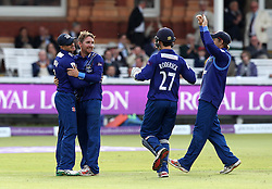 Gloucestershire's Tom Smith celebrates taking the wicket go Gary Wilson of Surrey CCC  - Mandatory byline: Robbie Stephenson/JMP - 07966 386802 - 19/09/2015 - Cricket - Lord's Cricket Ground - London, England - Gloucestershire CCC v Surrey CCC - Royal London One-Day Cup Final