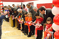 Dignitaries including Ohio Board of Education member Jeffrey Mims, DPS superintendent Lori Ward, school principal Shawna Welch, David Ponitz, Dayton Mayor Gary Leitzell and Joe Lacey watch and help students cut the ribbon during the dedication of Wright Brothers PK-8 School in Dayton and celebration of the completion of the 10 year Dayton Public Schools building project, Sunday, January 8, 2012.