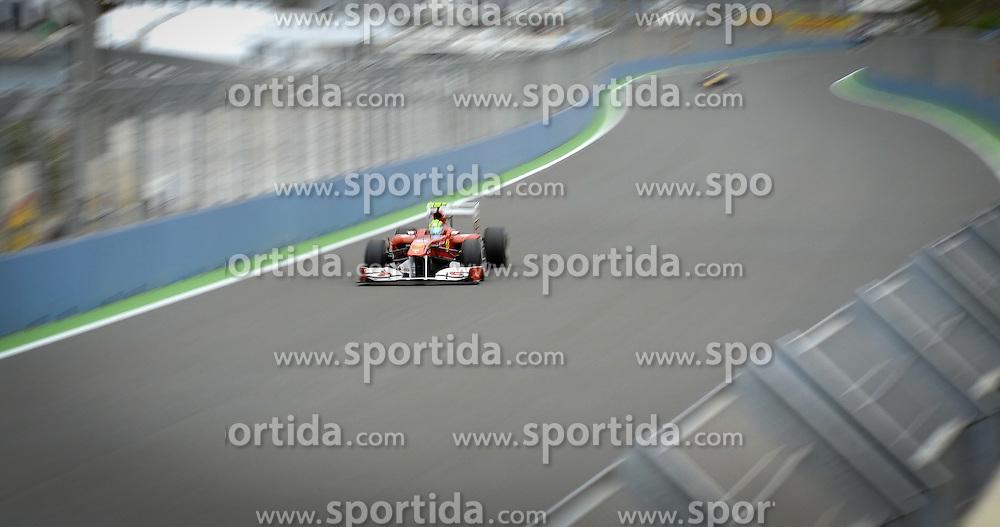 24.06.2011, Valencia-Street-Circuit, Silverstone, ESP, Großer Preis von Europa, Valencia, RACE 08, im Bild  DHL Branding - Felipe Massa (BRA), Scuderia Ferrari    EXPA Pictures © 2011, PhotoCredit: EXPA/ nph/  Dieter Mathis        ****** only for AUT, POL & SLO ******