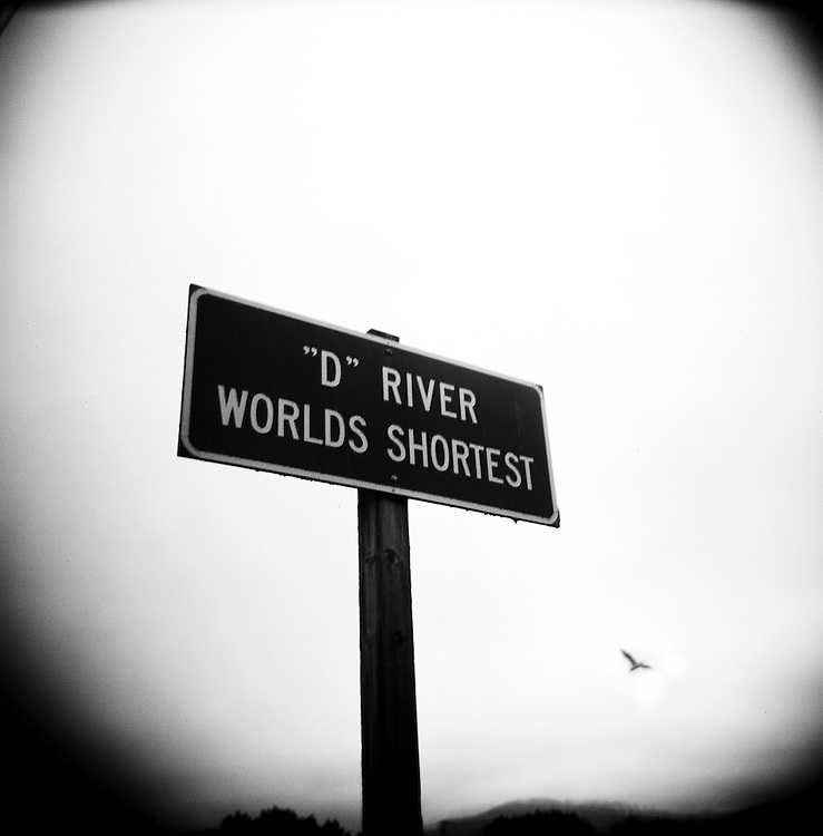 "Though the D River's honor of ""world's shortest river"" was challenged in 1987 by a group of ornery schoolchildren in Great Falls, Mont., the celebratory signs along Highway 101 in Lincoln City remain...""It's 105 feet, give or take five feet,"" said Jill Elfstrom, longtime employee of Kyllo's Seafood Grill, the restaurant that sits along side the river for most of its length. ""Devil's Lake is a spring-fed lake, so [the body of water that connects it to the Pacific Ocean] fits all the criteria of being a river. I'm an old-time Lincoln City resident, and we like our information correct.""..On the beach, Jody McDonald of Salem showed the river to friends visiting from Texas, including Melissa White, who grew up in Portland...""Growing up, we used to go to Cannon Beach, but that's gotten kind of boring,"" White said. ""But I can't go home without coming to the beach.""..""Don't get wet!"" one of her friends exclaimed, as she stepped into the slow, shallow, legendary D River...""That's part of going to the beach,"" White responded."