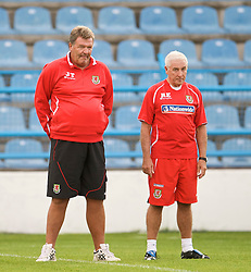 PODGORICA, MONTENEGRO - Tuesday, August 11, 2009: Wales' manager John Toshack MBE and assistant coach Roy Evans during a training session at the Gradski Stadion ahead of the international friendly match against Montenegro. (Photo by David Rawcliffe/Propaganda)