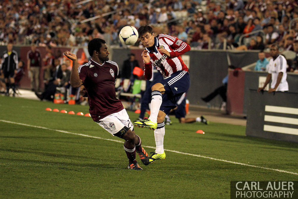August 18th, 2012: Chivas USA defender/midfielder Jorge Villafana (19) braces for a collision with Colorado Rapids defender Marvell Wynne (22) as he tries to  cross the ball in front of the Rapids goal in the second half at Dick's Sporting Goods Park