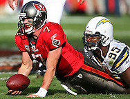 TP_299213_FITT_bucs_3.BRENDAN FITTERER | Times.(12/21/2008 Tampa) A bloody Bucs quarterback Jeff Garcia (7) is sacked on third and three in the fourth quarter by Shaun Phillips...SUMMARY: Tampa Bay Buccaneers vs. San Diego Chargers