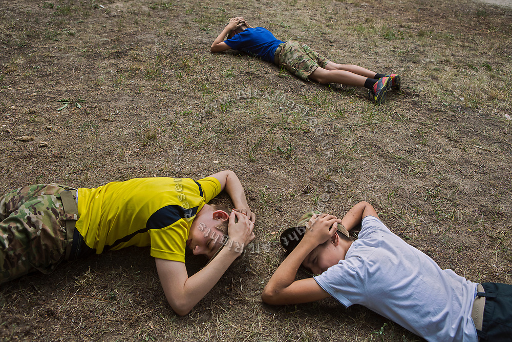 Youngsters participating to the ultra-nationalistic Azovets children's camp are learning how to protect themselves when being shelled, during tactical training on the banks of the Dnieper river, in Kiev, Ukraine's capital.