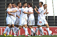 Picture by David Horn/Focus Images Ltd +44 7545 970036.29/09/2012.Charlie Macdonald (left) of Milton Keynes Dons celebrates scoring the opening goal with team mates during the npower League 1 match at stadium:mk, Milton Keynes.