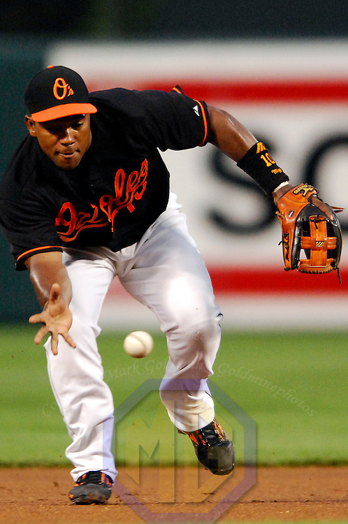 27 July 2007:  Baltimore Orioles shortstop Miguel Tejada (10) barehands a slowly hit ground ball and throws out New York Yankees center fielder Johnny Damon in the 1st inning.  The Orioles defeated the Yankees 4-2 at Camden Yards in Baltimore, MD.   ****For Editorial Use Only****