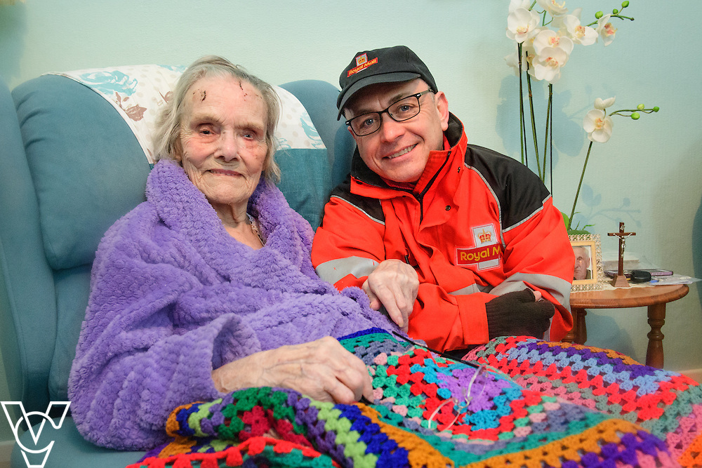 *** AT THE REQUEST OF MRS DUFFY, THIS IMAGE IS ONLY FOR USE IN THE ROYAL MAIL'S COURIER NEWSPAPER - NO OTHER USE ALLOWED *** <br /> <br /> Royal Mail postman Brian Willmott, who is based in Rugby, has been hailed a hero after helping an elderly female customer following a serious fall.  Mr Willmott met with Margaret Duffy on his delivery round today for the first time since her fall.  Pictured is Brian Willmott with Margaret Duffy.<br /> <br /> Picture: Chris Vaughan Photography<br /> Date: March 3, 2017