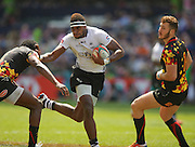 Semi Kunatani of Fiji fends off a tackler in the first half during the Hong Kong Sevens 2015 match between Fiji Sevens and Belgium  Sevens at the Hong Kong Stadium, Hong Kong on 28 March 2015. Photo by Ian Muir....during the Hong Kong Sevens 2015 match between ........... at Hong Kong Stadium, Hong Kong on 27 March 2015. Photo by Ian Muir.