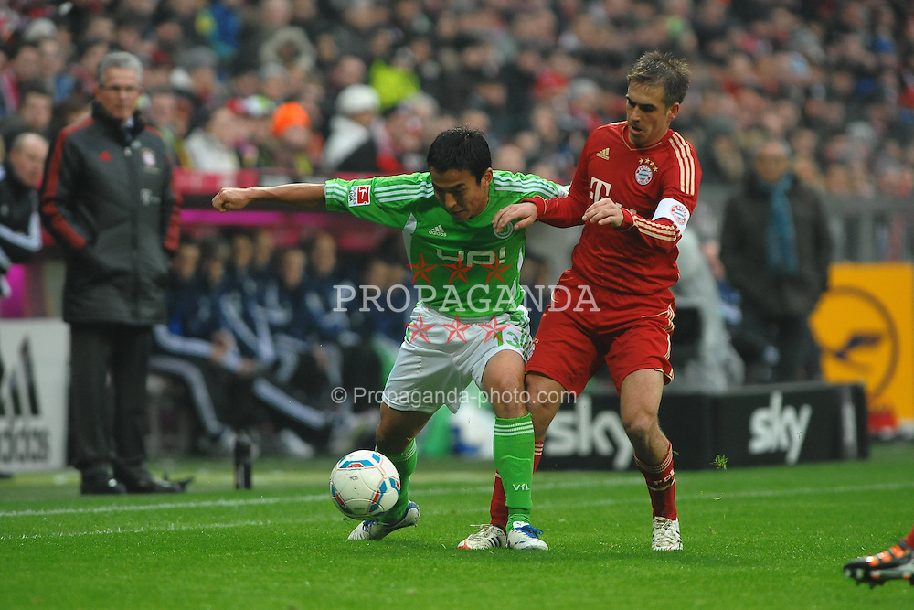 "28.01.2012, Allianz Arena, Muenchen, GER, 1. FBL, Bayern Muenchen vs VFL Wolfsburg, 19. Spieltag, im Bild Links Makote HASEBE (VfL Wolfsburg), rechts Philipp LAHM (FC Bayern Muenchen). Action,Aktion // during the football match of the german ""Bundesliga"", 19th round, between GER, 1. FBL, Bayern Munich and VFL Wolfsburg, at the Allianz Arena, Munich, Germany on 2012/01/28. EXPA Pictures © 2012, PhotoCredit: EXPA/ Eibner/ Wolfgang Stuetzle..***** ATTENTION - OUT OF GER *****"