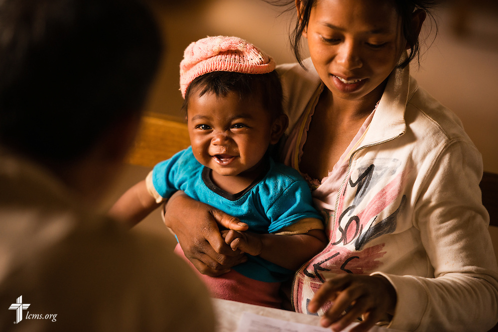 A mother and her baby receives treatment during the Mercy Medical Team clinic on Saturday, Oct. 18, 2014, at a Fiangonana Loterana Malagasy (FLM) Lutheran church in Antsoantany, Madagascar. LCMS Communications/Erik M. Lunsford