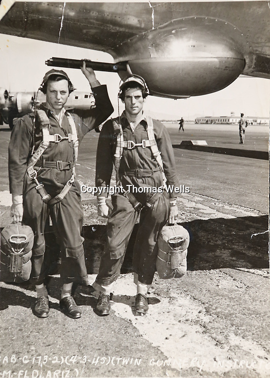 Wallace Crumby, right, and his twin brother take a photo with their B-29 superfortress before takeoff.