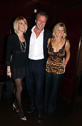 Left to right, LADY EMILY COMPTON, HUGO BURNAND and the MARCHIONESS OF MILFORD HAVEN at The Christmas Cracker - an evening i aid of the Starlight Children's Charity held at Frankies, Knightsbridge on 13th December 2006.<br /><br />NON EXCLUSIVE - WORLD RIGHTS