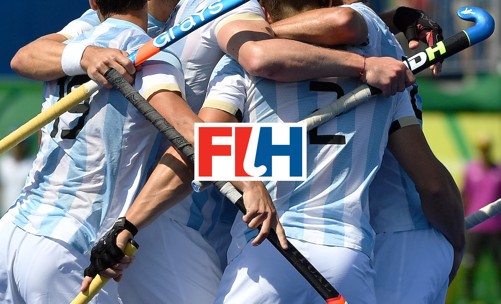 Argentina's Gonzalo Peillat (2nd R) celebrates the opening goal with teammates during the men's semifinal field hockey Argentina vs Germany match of the Rio 2016 Olympics Games at the Olympic Hockey Centre in Rio de Janeiro on August 16, 2016. / AFP / Pascal GUYOT        (Photo credit should read PASCAL GUYOT/AFP/Getty Images)