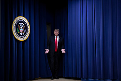 US President Donald Trump arrives before signing the Farm Bill into law at the White House in Washington, DC on December 20, 2018. Credit: Alex Edelman / CNP