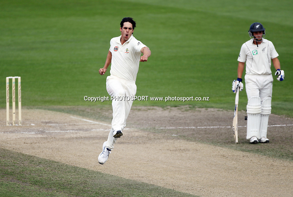 Australian pace bowler Mitchell Johnson celebrates the wicket of Tim McIntosh.<br />
