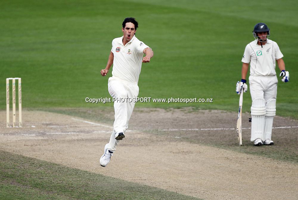Australian pace bowler Mitchell Johnson celebrates the wicket of Tim McIntosh.<br />Test Match Cricket. 2nd test. Day 4.<br />New Zealand Black Caps versus Australia. Seddon Park, Hamilton, New Zealand. Tuesday 30 March 2010. <br />Photo: Andrew Cornaga/PHOTOSPORT