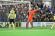 Mark Cousins (goalkeeper) of Dagenham & Redbridge headlocks  Lyle Taylor of AFC Wimbledon during the Sky Bet League 2 match between AFC Wimbledon and Dagenham and Redbridge at the Cherry Red Records Stadium, Kingston, England on 24 November 2015. Photo by Stuart Butcher.