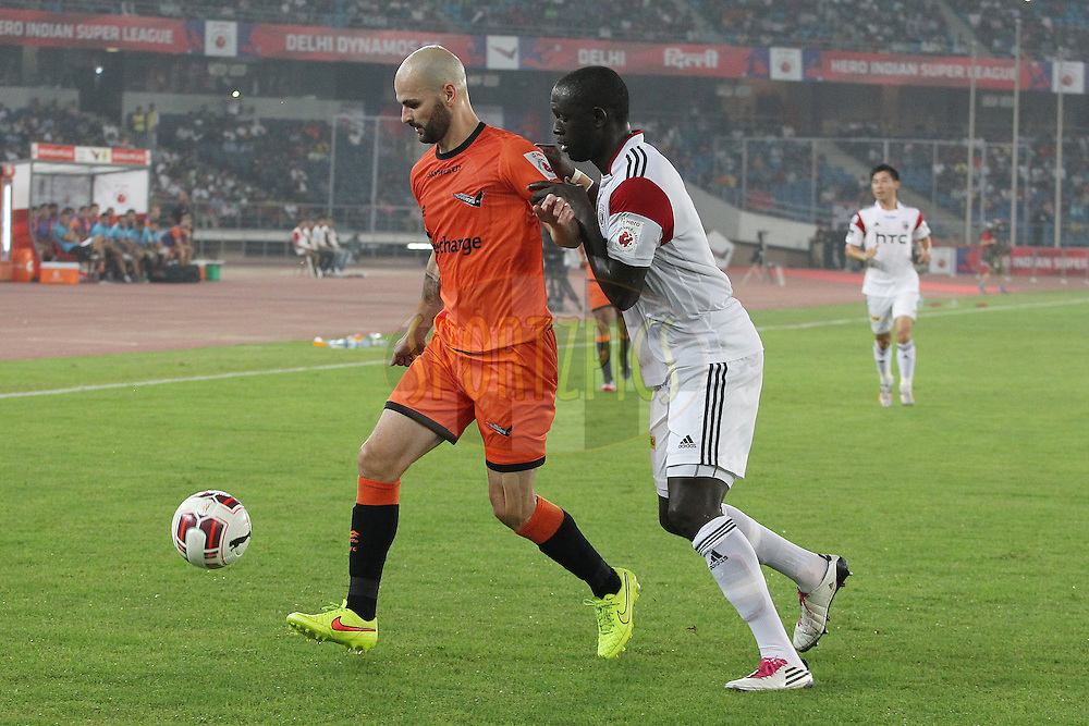 Hans Mulder of Delhi Dynamos FC and Massamba Lo Sambou of NorthEast United FC during match 16 of the Hero Indian Super League between The Delhi Dynamos FC and NorthEast United FC held at the Jawaharlal Nehru Stadium, Delhi, India on the 29th October 2014.<br /> <br /> Photo by:  Ron Gaunt/ ISL/ SPORTZPICS