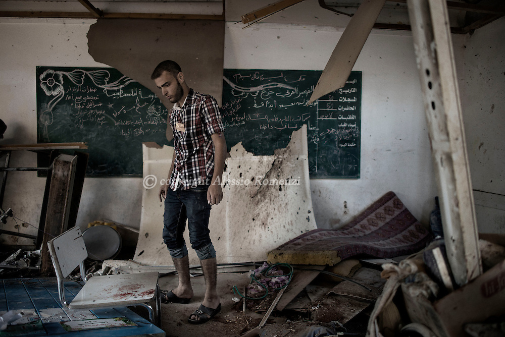 Gaza Strip, Jabalia refugee camp: A Palestinian is seen as he stands inside a destroyed by shelling classroom in the UNRWA (United Nations Relief and Work Agency) Jabalia refugee camp school on July 30, 2014. ALESSIO ROMENZI