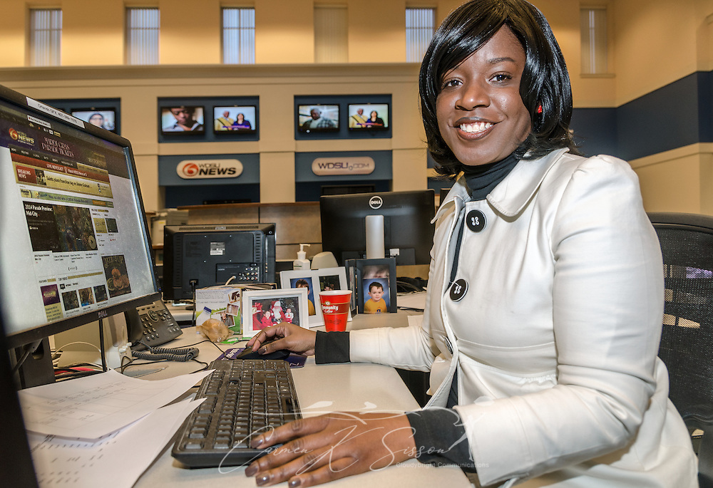 Aretha Frison sits in the newsroom at WDSU-TV station in New Orleans, La., Feb. 28, 2014. Frison, who works as a news producer at WDSU, was born in Detroit but moved to New Orleans in 2006. Frison is part of a growing number of African-Americans who are relocating from the North to the South. The 2000 Census marked the first time the South's black population has increased in more than a century. (Photo by Carmen K. Sisson/Cloudybright)