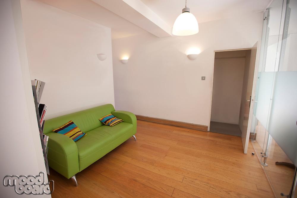 Green sofa in empty office
