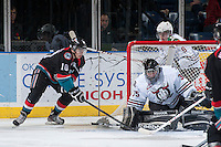 KELOWNA, CANADA - NOVEMBER 6: Nick Merkley #10 of the Kelowna Rockets makes an attempt at a wrap around goal agains Patrik Bartosak #35 of the Red Deer Rebels on NOVEMBER 6, 2013 at Prospera Place in Kelowna, British Columbia, Canada.   (Photo by Marissa Baecker/Shoot the Breeze)  ***  Local Caption  ***