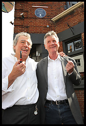 Former Monty Python stars Terry Jones and Michael Palin  at the unveiling of a blue plaque dedicated to fellow Python Graham Chapman at his local pub the Angel in Highgate, North London, Thursday, 6th September 2012  Photo by: Stephen Lock / i-Images