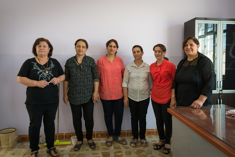 11 October 2017 &ndash; Ninewa Plains &ndash; Iraq &ndash; The Principal of the Mareem al Adhraa High School stands for a photo with teachers in an office they're busy preparing to be occupied. <br /> <br /> UNDP&rsquo;s Funding Facility for Stabilization is helping rehabilitate the school, which re-opened on October 7, 2017. &ldquo;All of us are happy,&rdquo; said Principal Amal Azzu Petros. <br /> <br /> &copy; UNDP Iraq / Claire Thomas