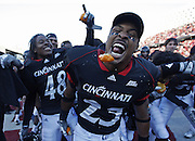 2008.11.29 UCFOOTBALL SPORTS :  The Unversity of Cincinnati's Isaiah Pead takes a bight out f an Orange celebrating their Big East Conference Championship and win over Syracuse at Nippert Stadium Saturday November 29, 2008. The Enquirer/Jeff Swinger