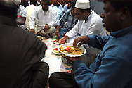 Roma 13 September 2007.Iftar  evening meal for breaking the daily fast during the Islamic month of Ramadan, in the small mosque to Tor Pignattara  visited by immigrants from Bangladesh.Iftar la cena per rpmpere il digiuno nel mese del  Ramadan nella piccola Moschea di Tor Pignattara frequentata  da immigrati del Bangladesh