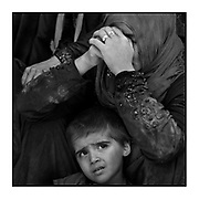 Faces of Mosul<br /> <br /> A collection of images from 4 time Pulitzer prize winning photographer Carol Guzy, gives us a glimpse into the faces of those affected by the fierce conflict with ISIS in Mosul. Wounded and weak, most who survived now face an uncertain future in the limbo of IDP camps. Shattered lives, lost loved ones and escape from the rubble of collapsed homes and the evil of ISIS doctrine, leaves scars of emotional trauma even more difficult to heal. The war in Mosul is over, but the humanitarian crisis continues.<br /> <br /> Mosul, Iraq - Civilians, many injured and weak, flee as battle with ISIS continues in West Mosul amid ruins of the Old City. <br />  ©Carol Guzy/zReportage.com/Exclusivepix Media