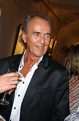 DAVID SHILLING and a model at a private view of fashion designer Lindka Cierach's Couture Dresses drawn by Trudy Good held at the Belgravia Gallery, 45 Albemarle Street, London on 21st September 2005.<br /><br />NON EXCLUSIVE - WORLD RIGHTS