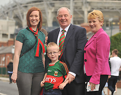 Minister Michael Ring TD with his wife Ann, daughter Susanne McGreal and grandson Rory on their way to the All Ireland Semi-final between Mayo and Dublin on sunday last.<br /> Pic Conor McKeown