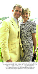 MR GRANT BOVEY and his wife tv presenter ANTHEA TURNER,  at a polo match in West Sussex on 22nd July 2001.	ORL 124