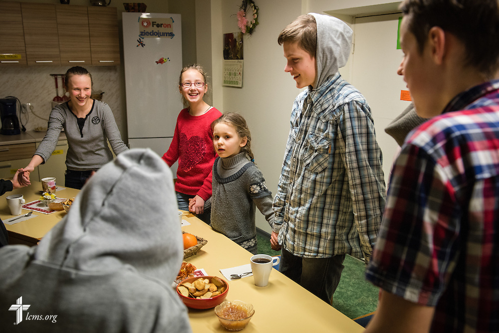 Children pray during evening snack time on Wednesday, Feb. 4, 2015, at the Generations Diaconia Center daycare in Riga, Latvia. LCMS Communications/Erik M. Lunsford