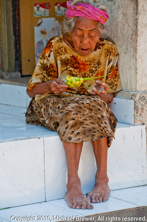 Old woman basket weaving on Nusa Penida, Bali, Indonesia