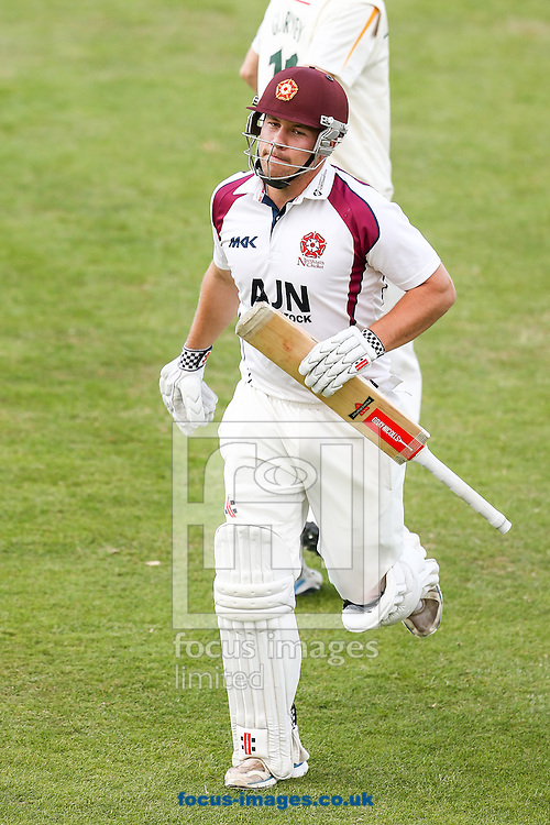 Adam Rossington of Northamptonshire County Cricket Club leaves the field after scoring 103 runs during the LV County Championship Div One match at the County Ground, Northampton.<br /> Picture by Andy Kearns/Focus Images Ltd 0781 864 4264<br /> 15/08/2014
