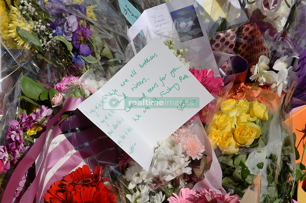 Floral tributes left close to Finsbury Park Mosque in north London, after a van was driven into pedestrians near the north London mosque, leaving one man dead and eight injured.